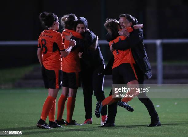 Glasgow City manager Scott Booth celebrates with Nicola Docherty of Glasgow City during the UEFA Women's Champions League Round of 32 2nd Leg match...