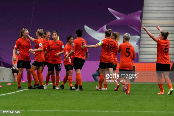 Glasgow City's Northern Irish midfielder Lauren Wade celebrates with teammates after scoring a goal during the UEFA Women's Champions League...