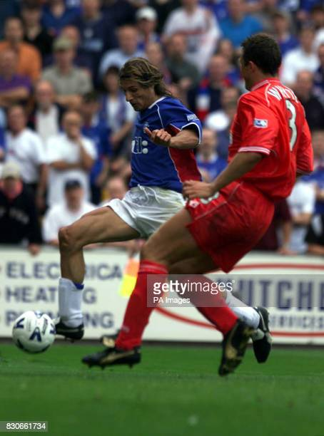 Glasgow Rangers' Claudio Caniggia gets away from Aberdeen's Derek Whyte to score his first goal for the club during the Scottish Premier League...