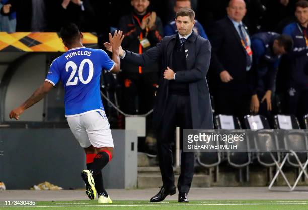 Glasgow Rangers' Colombian forward Alfredo Morelos celebrates with Glasgow Rangers' English head coach Steven Gerrard after scoring a goal during the...