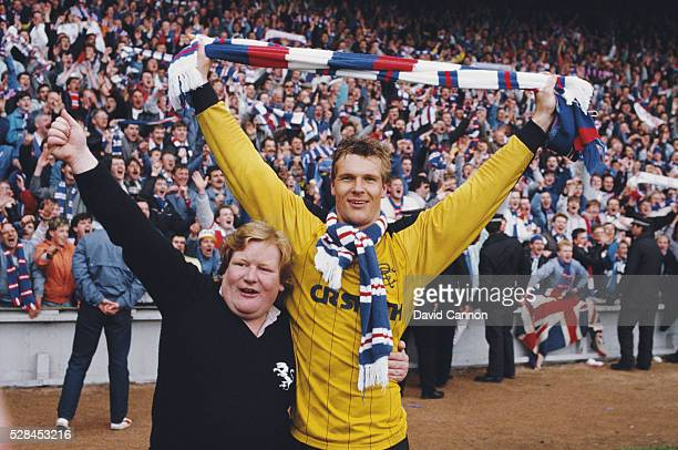 Glasgow Rangers goalkeeper Chris Woods and fan celebrate after the 1-1 draw with Aberdeen at Pittodrie confirmed Rangers as Premier winners on May 2,...