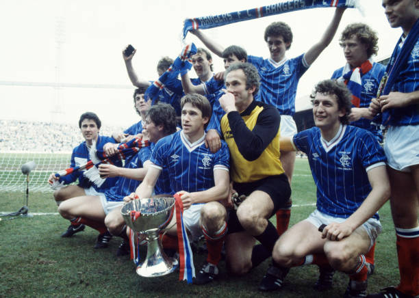 GLASGOW, SCOTLAND - MARCH 25: Glasgow Rangers players celebrate with the trophy after the Scottish League Cup Final between Glasgow Rangers and Glasgow Celtic at Hampden Park on March 25, 1984 in Glasgow, Scotland. Rangers won 3-2 (aet). Back row (left-right): Dave McPherson, (hidden), Hugh Burns, (unknown), Craig Paterson, Jimmy Nicholl and (unknown). Front row: (unknown), (hidden), Ally McCoist, John McClelland, Peter McCloy and Colin McAdam.