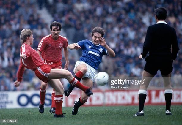 Glasgow Rangers striker Aly McCoist challenges Aberdeen's Stuart McKimmie watched by Brian Mitchell during the match at Ibrox Stadium in Glasgow 28th...
