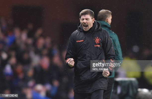 Glasgow Rangers team manager Steven Gerrard celebrates after Glasgow Rangers' Colombian forward Alfredo Morelos scores his team's first goal during...
