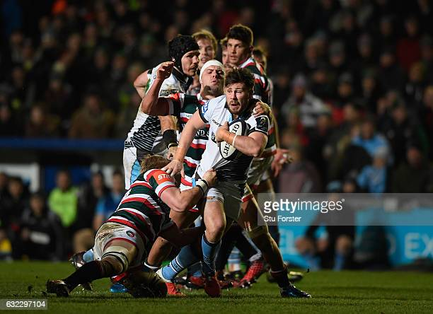 Glasgow scrum half Ali Price makes a break during the European Rugby Champions Cup match between Leicester Tigers and Glasgow Warriors at Welford...