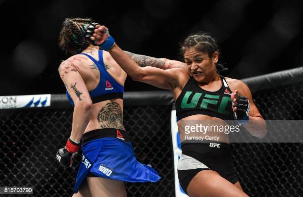 Glasgow United Kingdom 16 July 2017 Joanne Calderwood left in action against Cynthia Calvillo during their strawweight bout at UFC Fight Night...