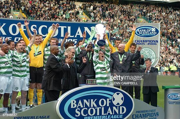 Glasgow Celtic team captain Neil Lennon lifts the Bank of Scotland Premier League trophy 16 April 2006 as his team mates celebrate The team was...