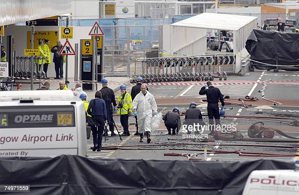 Investigators examine 01 July 2007 the area where a burning car slammed into a terminal at Glasgow airport a day after the attack Glasgow airport was...
