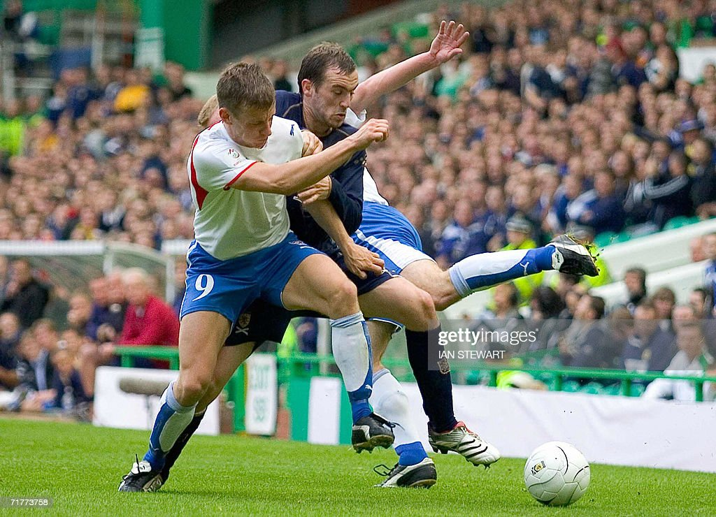 Jakob a Borg tackles Scotland's James McFadden during the match at Celtic Park in Glasgow, 02 September 2008. Scotland beat the Faroes 6-0.