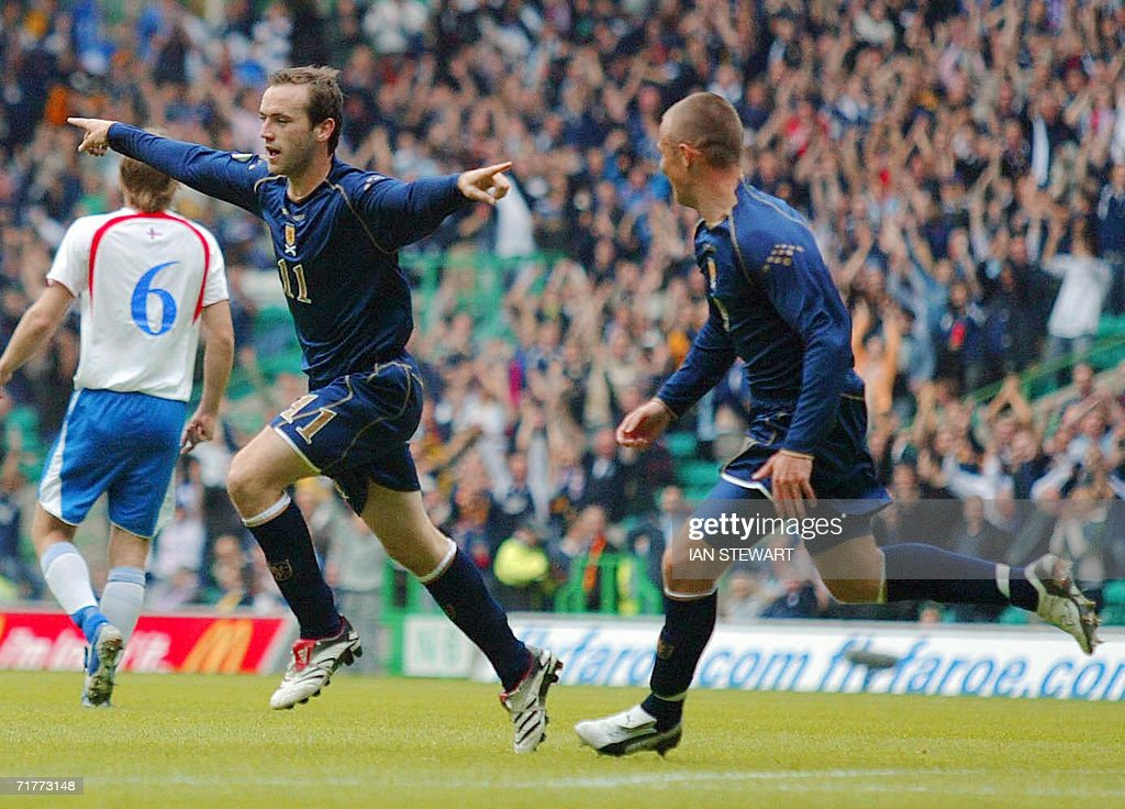 James McFadden celebrates with Kenny Miller (R) after he scored Scotland's 2nd goal against Faroe Islands at Celtic Park in Glasgow, in a European Championship Group B qualifier 02 September 2008.