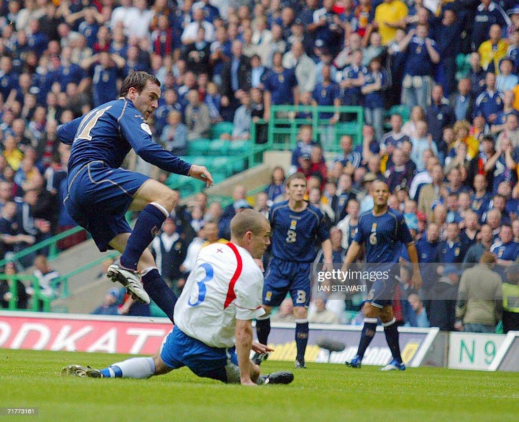 James McFadden (L) scores Scotland's 2nd goal against Faroe Islands, past Janus Joensen, at Celtic Park in Glasgow, in a European Championship Group B qualifier 02 September 2008.