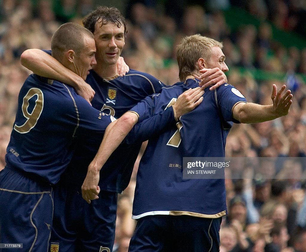 Kenny Miller, Christian Dailly and Darren Fletcher celebrate after Miller scored from the penalty spot against Faroe Islands at Celtic Park in Glasgow, in a European Championship Group B qualifier 02 September 2008.