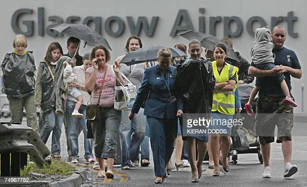 Passengers and airport staff flee from Glasgow Airport in Scotland 30 June 2007 after a jeep on fire drove into a terminal building at Glasgow...