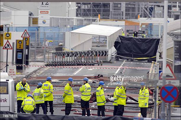 Police officers search 01 July 2007 the area where a burning car slammed into a terminal at Glasgow airport a day after the attack Glasgow airport...