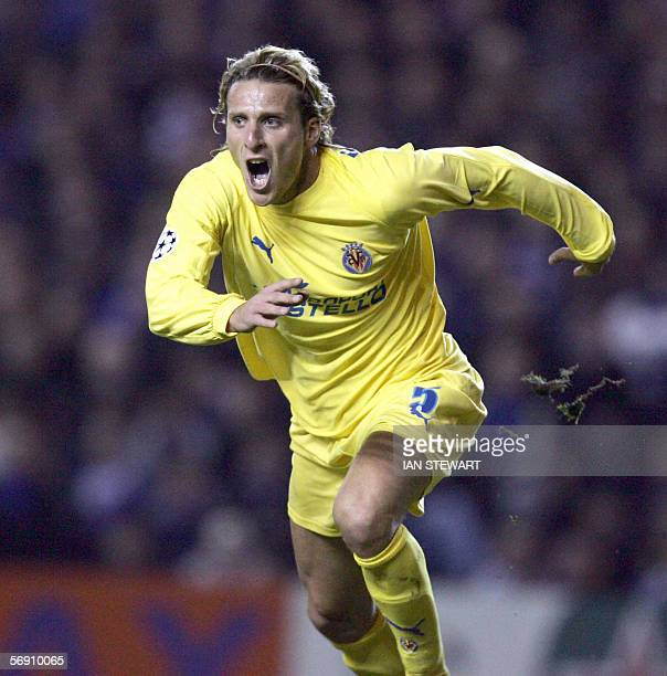 Uruguay 's forward Diego Forlan jubilates after he scored the second goal for Villarreal as part of the Champions League match opposing Villareal and...