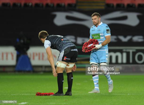 Glasgow Warriors' Adam Ashe and Ospreys' Olly Cracknell lay wreathes before kickoff during the Guinness Pro14 Round match between Ospreys and Glasgow...