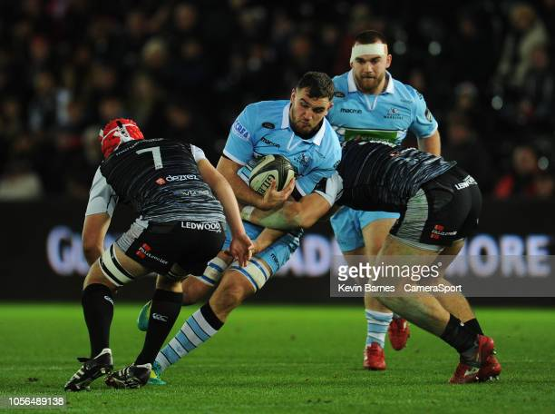 Glasgow Warriors' Adam Ashe is tackled by Ospreys' Rhodri Jones during the Guinness Pro14 Round match between Ospreys and Glasgow Warriors at Liberty...