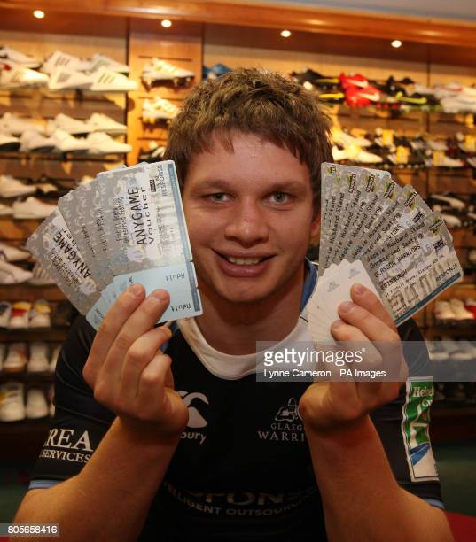 Glasgow Warriors' Calum Forrester promotes the selling of tickets at Greaves Sports in Glasgow