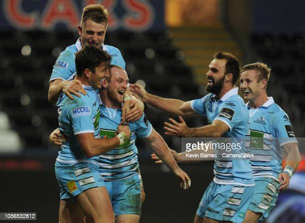 Glasgow Warriors' Nick Grigg celebrates scoring his sides fourth try with teammates during the Guinness Pro14 Round match between Ospreys and Glasgow...