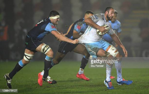 Glasgow Warriors player Kiran McDonald breaks the tackle of Rory Thornton of the Blues during the Guinness PRO14 match between Cardiff Blues and...