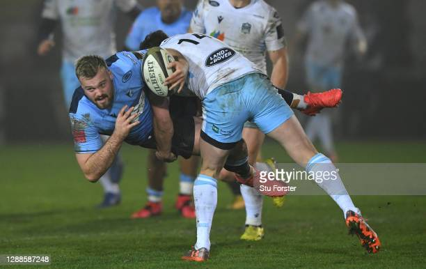 Glasgow Warriors player Lee Jones puts in a big tackle on Blues wing Owen Lane during the Guinness PRO14 match between Cardiff Blues and Glasgow...