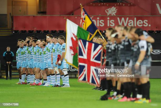 Glasgow Warriors players observe a minutes silence during the Guinness Pro14 Round match between Ospreys and Glasgow Warriors at Liberty Stadium on...