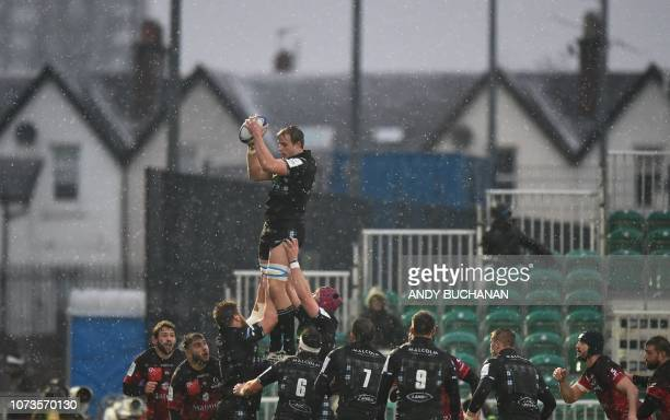 Glasgow Warriors' Scottish lock Jonny Gray wins the ball at the line out during the European Champions Cup rugby union pool match between Glasgow...