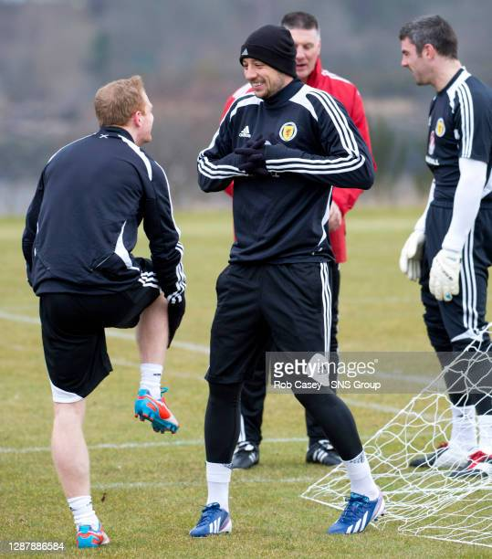 All smiles from Scotland team mates Chris Burke and Alan Hutton as they share a joke during training