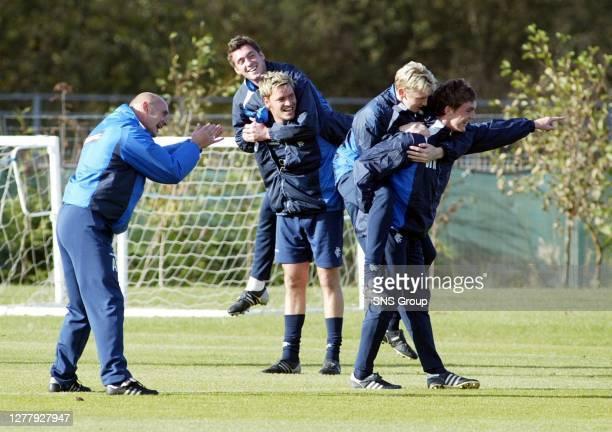 Andy Watson urges on players Maurice Ross , Stephen Hughes , Allan McGregor and Jesper Christiansen