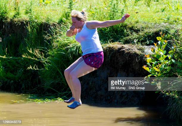 Carly Martin takes a chance to cool down from the Summer sun