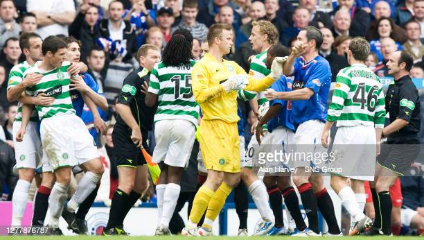 Celtic's Darren O'Dea is held back as tempers ignite between several Old Firm players including Artur Boruc and Rangers' David Weir