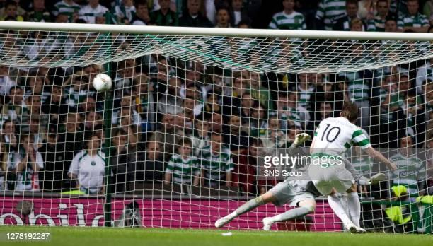 Celtic's Jan Vennegoor of Hesselink scores during penalties despite missing one in normal time past stipe Pletikosa