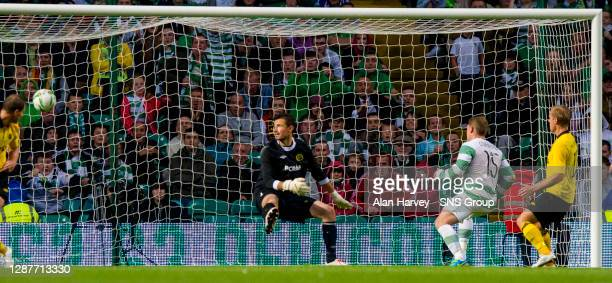 Celtic's Kris Commons heads the ball past Kevin Stuhr-Ellegaard to open the scoring.