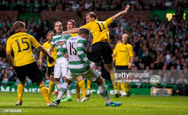 Celtic's Kris Commons heads the home side into the lead with the opening goal of the game.