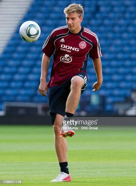 Denmark and Arsenal striker Nicklas Bendtner gets on the ball at training