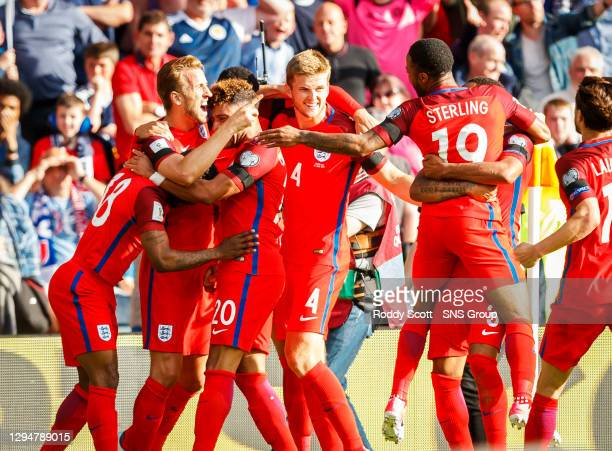 England players celebrate with Harry Kane after he scores his side's equalising goal