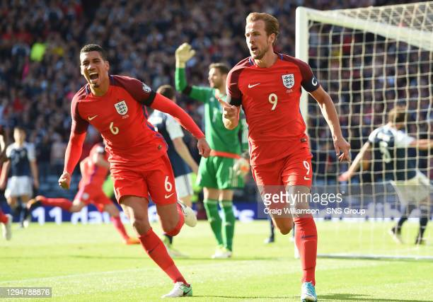 England's Harry Kane celebrates after volleying home the late equaliser