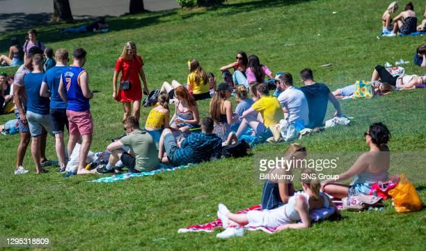 Glasgow residents enjoy the Sun in Kelvingrove Park.