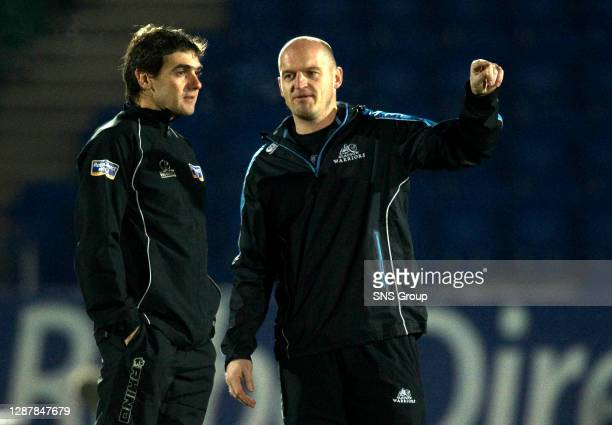 Glasgow Warriors head coach Gregor Townsend chats with match referee Jerome Garces before kick-off.