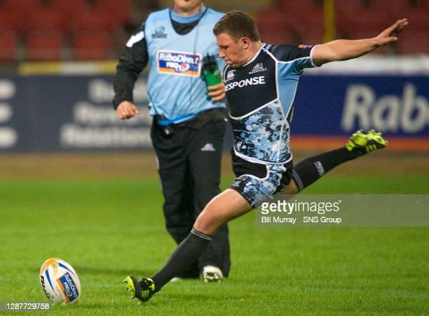 Glasgow's Duncan Weir attempts a kick at goal.