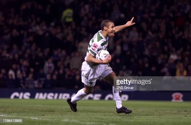Henrik Larsson wheels away to celebrate after scoring to further increase Celtic's lead