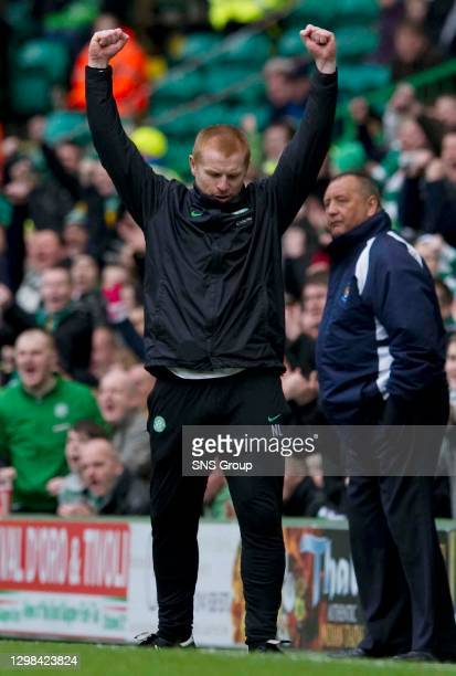 Interim Celtic manager Neil Lennon pumps his fist in the air after his side increase their lead