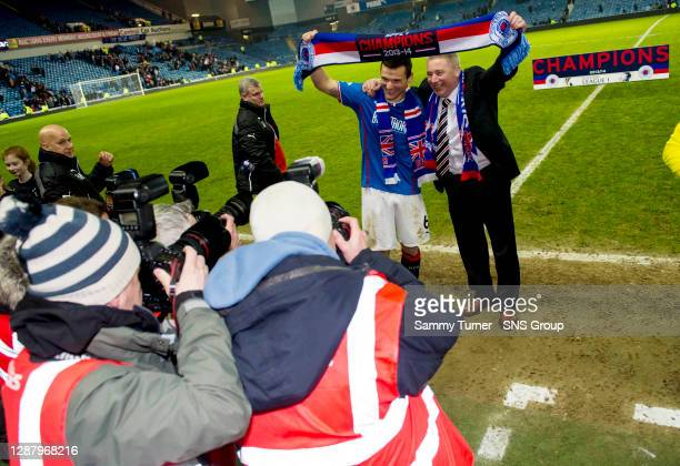 Rangers manager Ally McCoist and captain Lee McCulloch celebrate at full time after Rangers are crowned as Scottish League One champions.