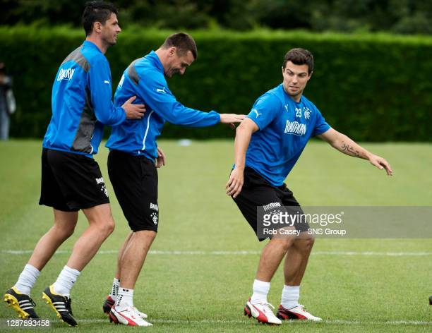 Rangers' Richard Foster larks around with captain Lee McCulloch and Emilson Cribari