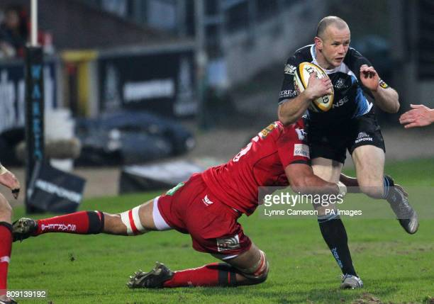 Glasgow's Hefin O'Hare is tackled by Scarlet's Scott Williams during the Magners League match at Firhill Stadium Glasgow