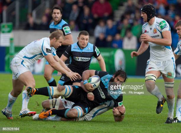 Glasgow's Josh Strauss is tackled by Exeter's Kai Horstmann and Jason Shoemark during the Heineken Cup Pool Two match at Scotsoun Stadium Glagsow