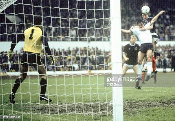 Scotland's Richard Gough outjumps Kenny Sansom to head the ball past goalkeeper Peter Shilton into the net for the match-winning goal
