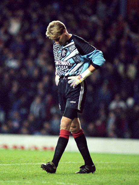 Substitute goalkeeper Billy Thomson hangs his head as Rangers suffer a heavy defeat to Juventus.