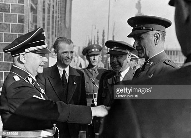 Glasmeier Heinrich 'Reichsintendant' GermanyGreeting the spanish 'Rundfunkgeneral' Queipo de Lllano left rear the director of the 'Deutsche...