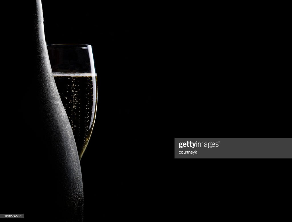 Glass and bottle of champagne : Stock Photo